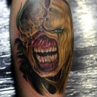 Horror style colored leg tattoo of monster from Resident Evil