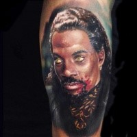 Horror style colored leg tattoo of vampire portrait
