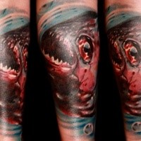 Horror style colored tattoo of bloody fish