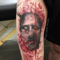 Horror style colored thigh tattoo of Hannibal Lectors head with creepy lettering