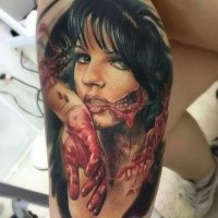 Horror style creepy looking biceps tattoo of zombie woman
