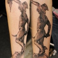 Horror style creepy looking forearm tattoo of antic warrior with Medusa head