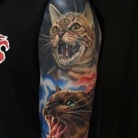 Horror style creepy looking shoulder tattoo of vampire cat