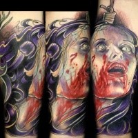 Horror style creepy looking tattoo of bloody woman head