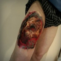 Horror style creepy looking thigh tattoo of evil mask
