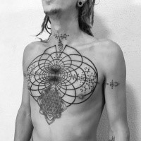 Hypnotic blackwork style chest tattoo of creative magical ornaments