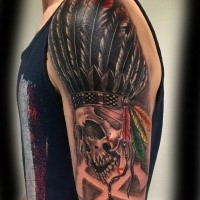 Illustrative style beautiful colored shoulder tattoo of Indian skull with big feather helmet