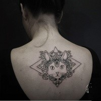 Illustrative style big upper back tattoo of cat stylized with various ornaments