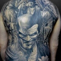 Illustrative style black ink back tattoo of half Batman half Joker
