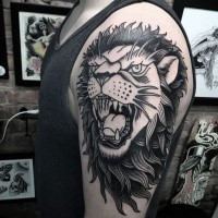 Illustrative style black ink shoulder tattoo of roaring lion