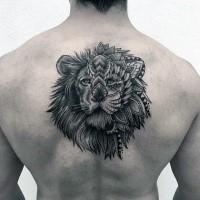 Illustrative style black ink upper back tattoo of lion head stylized with flowers