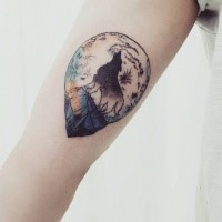 Illustrative style colored arm tattoo of wolf and night moon