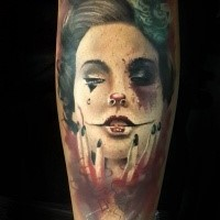 Illustrative style colored arm tattoo of creepy clown woman