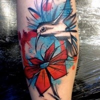 Illustrative style colored arm tattoo of flying bird with flower