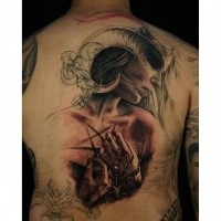 Illustrative style colored back tattoo of demonic woman with devils cross