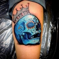 Illustrative style colored blue skull with small crown