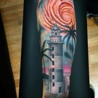 Illustrative style colored forearm tattoo of lighthouse with cool looking sun