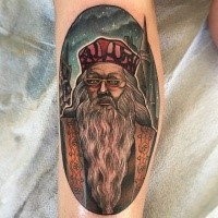 Illustrative style colored forearm tattoo of Harry Potter movie Dumbledore