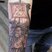 Illustrative style colored forearm tattoo of viking warrior with sailing ship