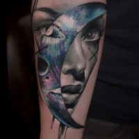 Illustrative style colored forearm tattoo of woman face with moon