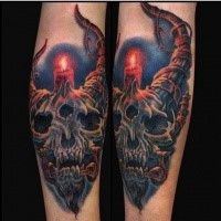 Illustrative style colored forearm tattoo of fantasy devil skull with candle