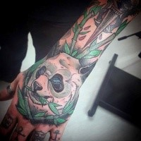 Illustrative style colored hand tattoo of panda bead with bamboo