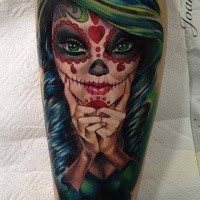 Illustrative style colored leg tattoo of Mexican woman face