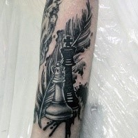 Illustrative style colored leg tattoo of chess figures and feather