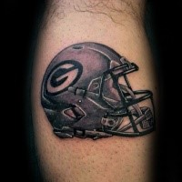 Illustrative style colored leg tattoo of American football helmet
