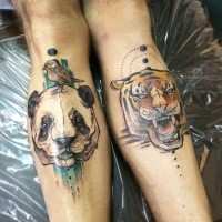 Illustrative style colored legs tattoo of tiger and panda heads