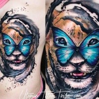Illustrative style colored lion with butterfly tattoo on side