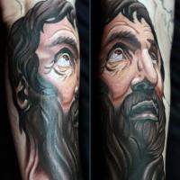 Illustrativer Stil gefärbter religiöser Mann Porträt Tattoo am Unterarm