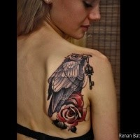 Illustrative style colored scapular tattoo of crow with key and rose