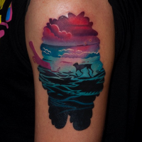 Illustrative style colored shoulder tattoo of monster silhouette stylized with dog running the sea