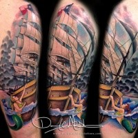 Illustrative style colored shoulder tattoo of sailing ship with mermaids