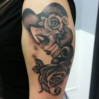 Illustrative style colored shoulder tattoo of Mexican style woman with rose