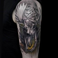 Illustrative style colored shoulder tattoo of interesting looking animal skull with birds