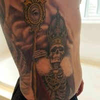 Illustrative style colored skeleton king with crown and staff tattoo on side