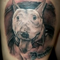 Illustrative style colored thigh tattoo of funny dog and lettering