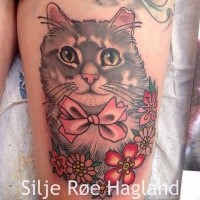 Illustrative style colored thigh tattoo of funny cat with flowers