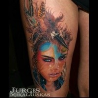Illustrative style colored thigh tattoo of beautiful woman with feather helmet