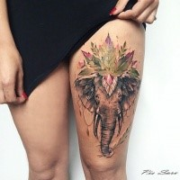 Illustrative style colored thigh tattoo of elephant with clover leaf