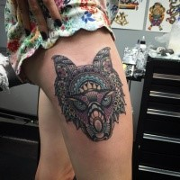 Illustrative style colored thigh tattoo of fantasy wolf with ornaments