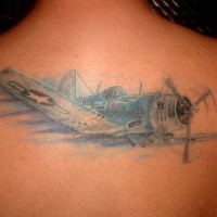 Illustrative style colored upper back tattoo of flying plane