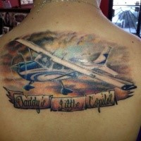 Illustrative style colored upper back tattoo of big plane with lettering