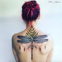 Illustrative style colored upper back tattoo of big dragonfly
