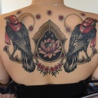 Illustrative style colored upper back tattoo of birds with flowers and symbols