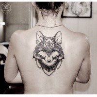 Illustrative style colored upper back tattoo of fantasy wolf