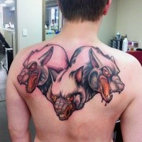Illustrative style colored upper back tattoo of cool Cerberus