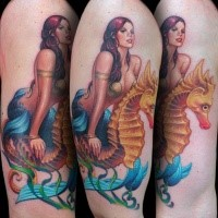 Illustrative style multicolored shoulder tattoo of mermaid with seahorse